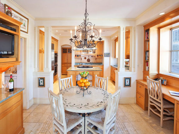 in-addition-to-the-large-formal-dining-room-the-kitchen-has-a-breakfast-nook-to-go-along-with-the-custom-cabinets-and-appliances