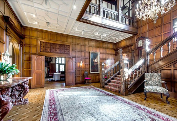 the-inside-decor-is-dramatic-with-high-ceilings-custom-millwork-and-decadent-chandeliers
