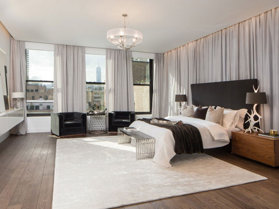 the-master-bedroom-is-also-very-spacious-offering-marvelous-views-of-the-city-below