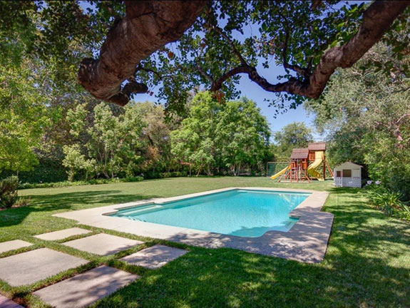 with-more-than-three-acres-the-estate-includes-a-saltwater-pool-and-playground