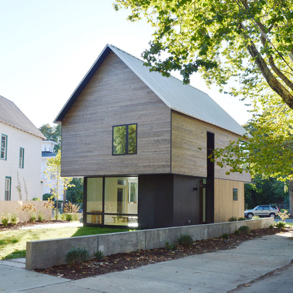 A cedar home by yale architects offers unique take on for Affordable built homes