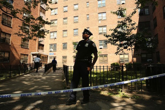 A police office outside NYCHA housing