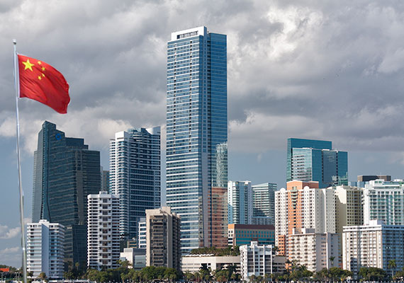 Miami's skyline from December 2011 (Credit: John Spade) and the Chinese flag