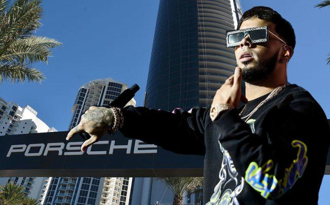 Anuel AA and Porsche Design Tower (Credit: Getty Images, Wikipedia)
