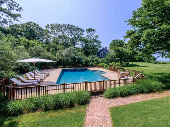 a-60-foot-pool-with-an-attached-hot-tub-calls-for-an-outdoor-party-the-changing-cabana-means-guests-wont-have-to-trek-back-to-the-house-to-put-on-their-swimsuits