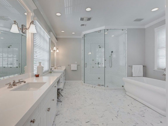 a-steam-shower-soaking-tub-and-his-and-her-sinks-line-the-walls-of-the-master-bath