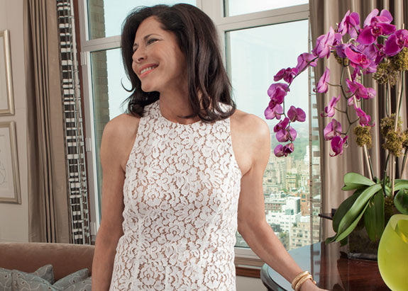 Sheila Rosenblum, wearing a Michael Kors Collection floral lace jumpsuit, in the living room of her Park Avenue duplex